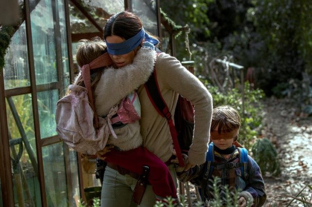 Malorie and her kids trying to escape in Bird Box.