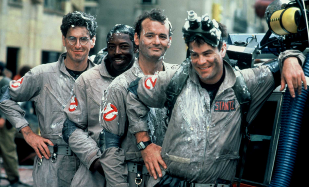 The original Ghostbusters in their classic victory pose.